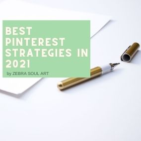 white minimal image with a pen and white paper. White text on green box: best pinterest strategies in 2021 by zebra soul art