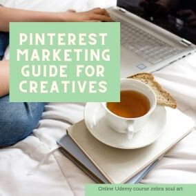 coffee on bed, laptop in background, text saying pinterest marketing guide for creatives by zebra soul art