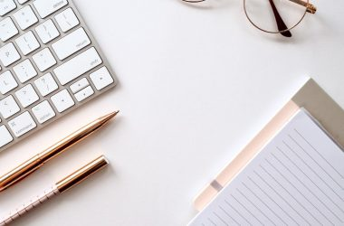 glasses, journal, keyboard and minimalistic white colors
